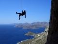 Kletterer vor blauem Himmel auf Extremsport-Welt